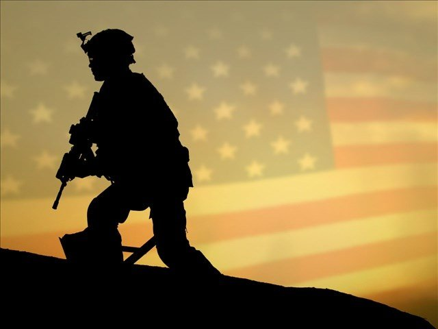 soldier_silhouette_with_flag Caption