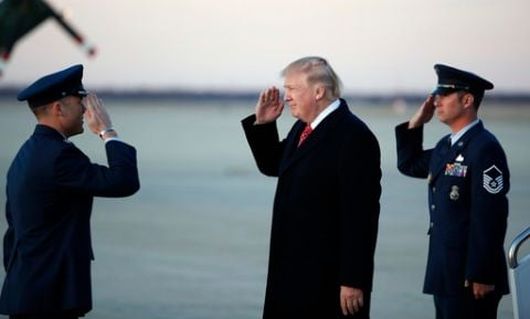 President Donald Trump salutes as he stands on the tarmac after disembarking Air Force One as he arrives Sunday, March 5, 2017, at Andrews Air Force Base, Md. Trump is returning from Mar-a-Largo, Fla.  Caption